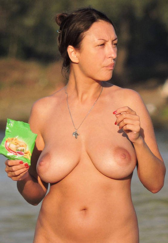 Amateur woman with big tits and shaved pussy naked on the beach 1