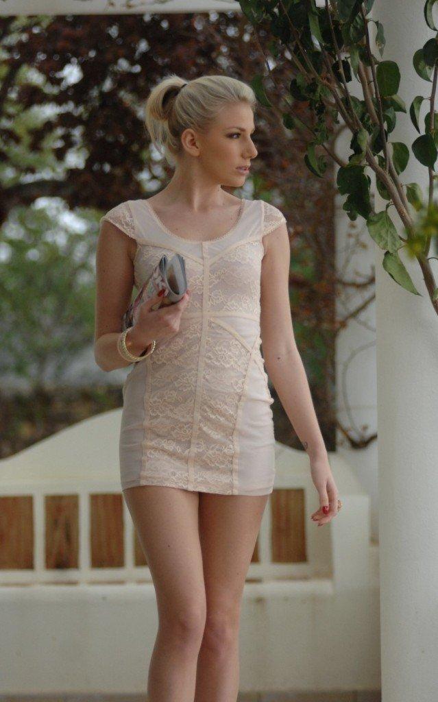 leggy hot blonde in sexy mini dress
