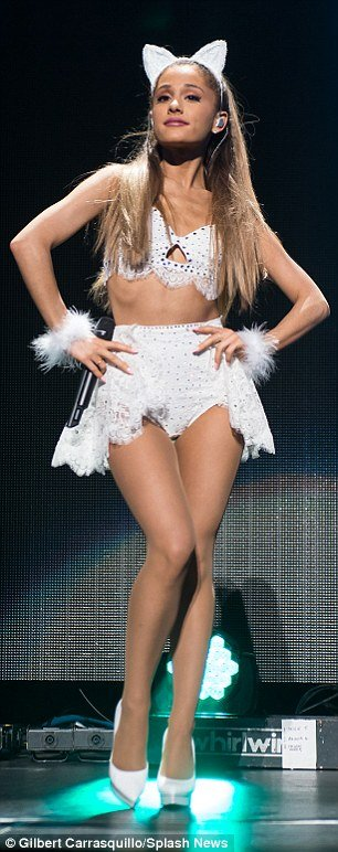 Ariana Grande hot posing in mini skirt on stage