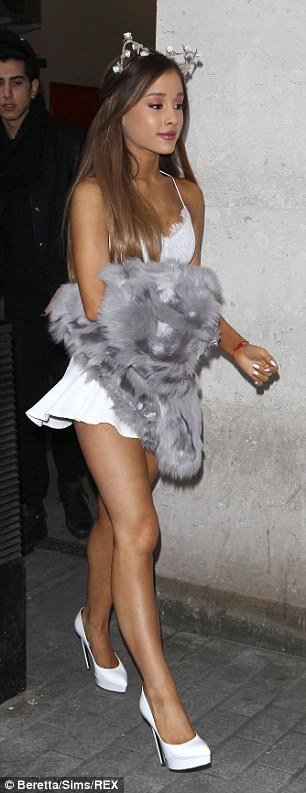 Ariana Grande with mini skirt in London photo 4