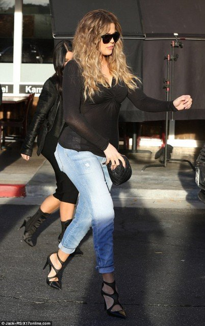 Kim Kardashian and Khloe asses