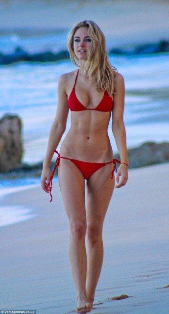 Kimberley Garner red bikini on the beach pic 1