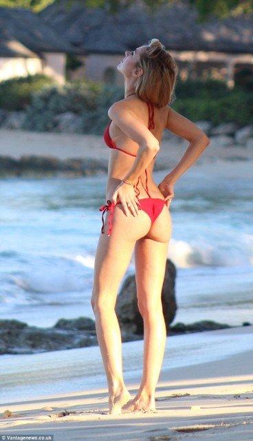 Kimberley Garner red bikini on the beach pic 4