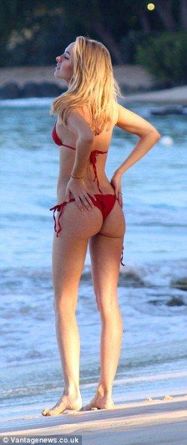 Kimberley Garner red bikini on the beach pic 6