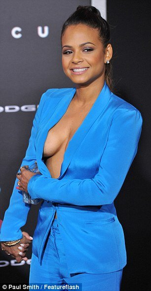 Christina Milian suffers wardrobe malfunction as she shows off sideboob