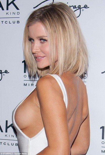 Joanna-Krupa braless sexy white dress at night club photo 2