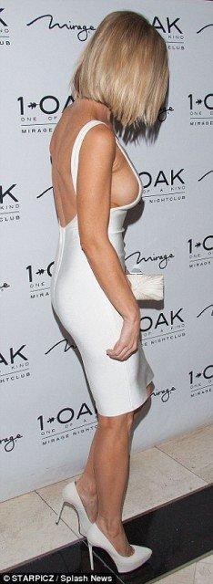 Joanna-Krupa braless sexy white dress at night club photo 4