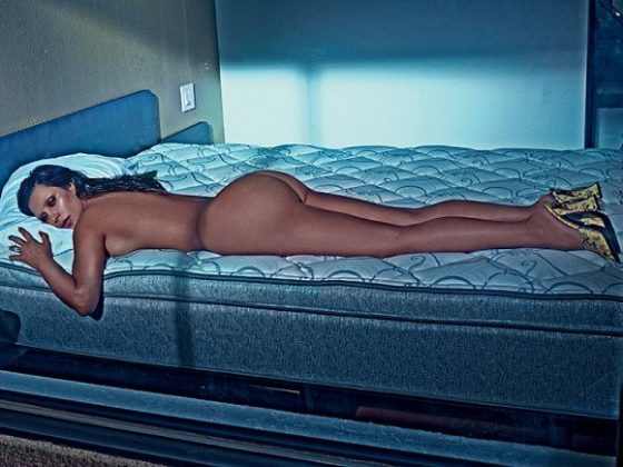 Kim Kardashian naked in bed