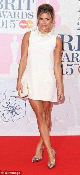 Zoe-Hardman legs in mini dress on red carpet