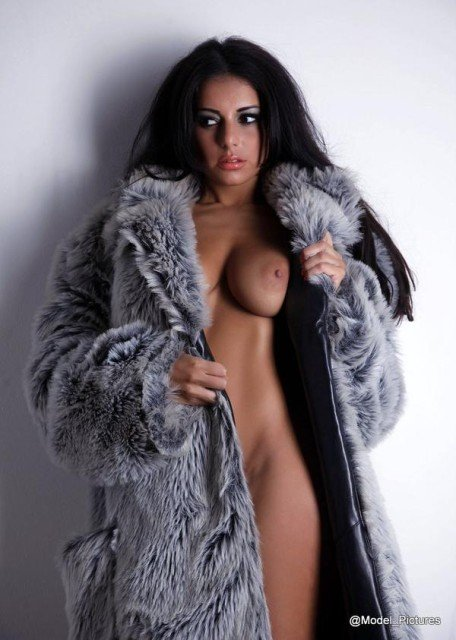Charlotte Springer in fur coat and naked