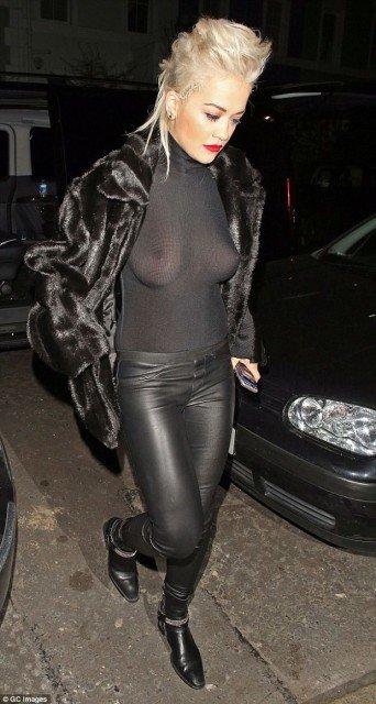 braless singer Rita Ora Flashes Nipples in Sheer Black Top photo 7