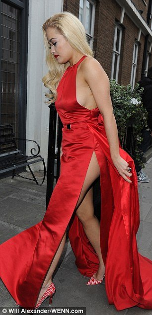 Rita Ora sideboob braless in red dress
