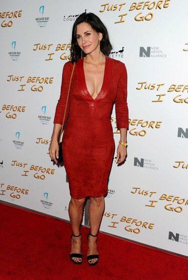 COURTENEY Cox sexy red plunging dress