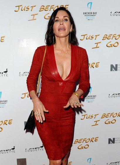 Courteney Cox with impressive red plunging dress at a special screening for her new film Just Before I Go