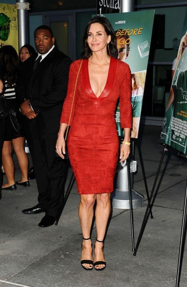 COURTENEY Cox sexy red dress at a special screening