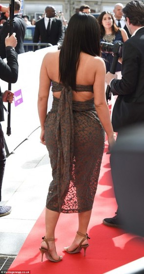 Kim Kardashian butt in semi sheer dress