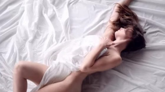 Laeticia Casta sexy on bed for perfume commercial video