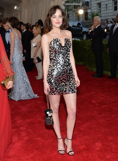 Dakota Johnson hot legs in strapless mini dress