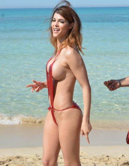 Micaela Schafer barely covers boobs in super sexy swimsuit