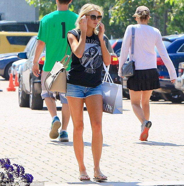 Hot blonde Charlotte McKinney toned legs in tiny denim shorts photo 1