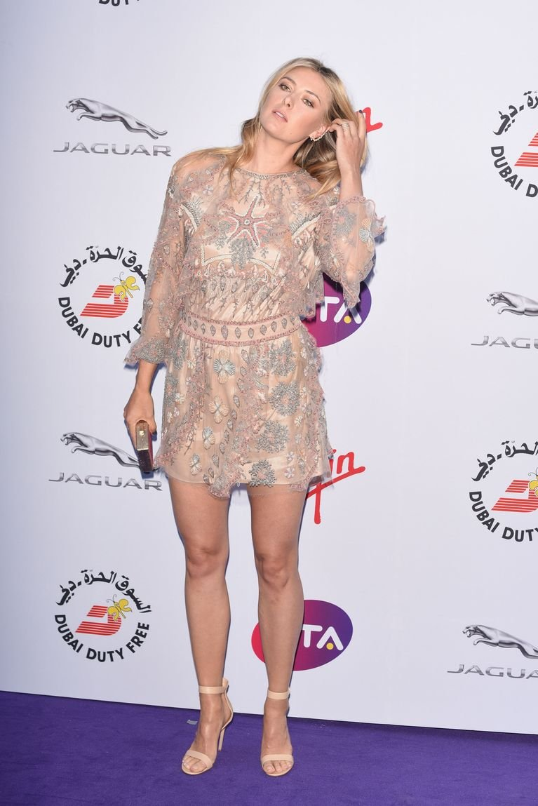 Maria Sharapova showed off her toned legs wearing a glam mini dress