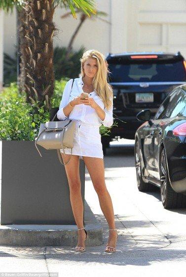 Stunning Charlotte McKinney shows off hot legs in mini skirt