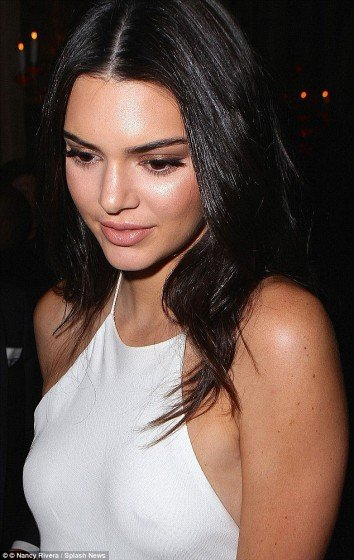Kendall Jenner beautiful young celebrity with nipple piercing in braless dress