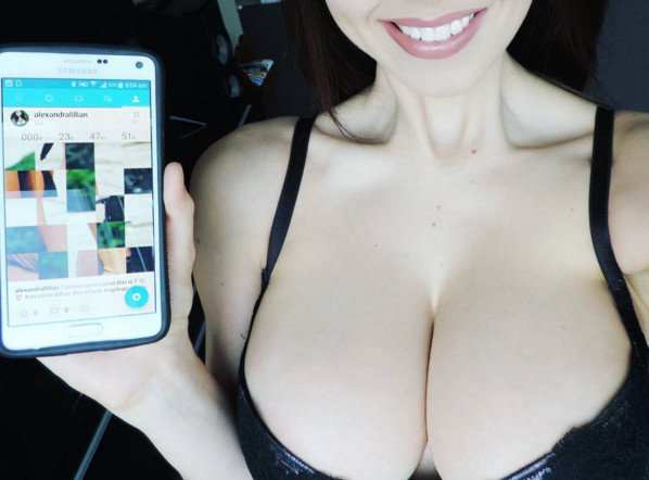 huge boobs cleavage girl with a cellphone