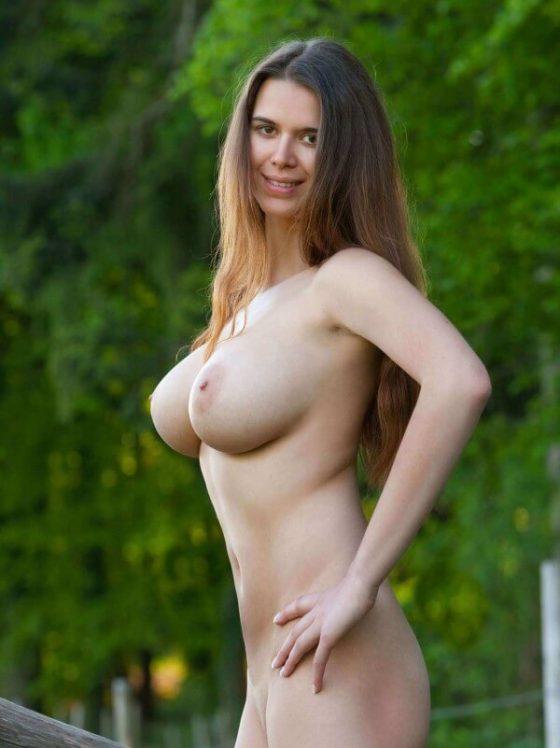 Femjoy presents amazing natural busty girl Karoline naked outdoors