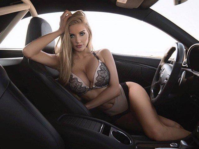 Beautiful woman in lingerie inside a car