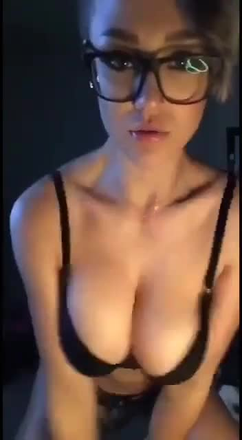 Watch big tits girl with glasses removes her bra