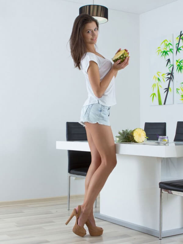 hot young girl with long legs in sexy jean shorts