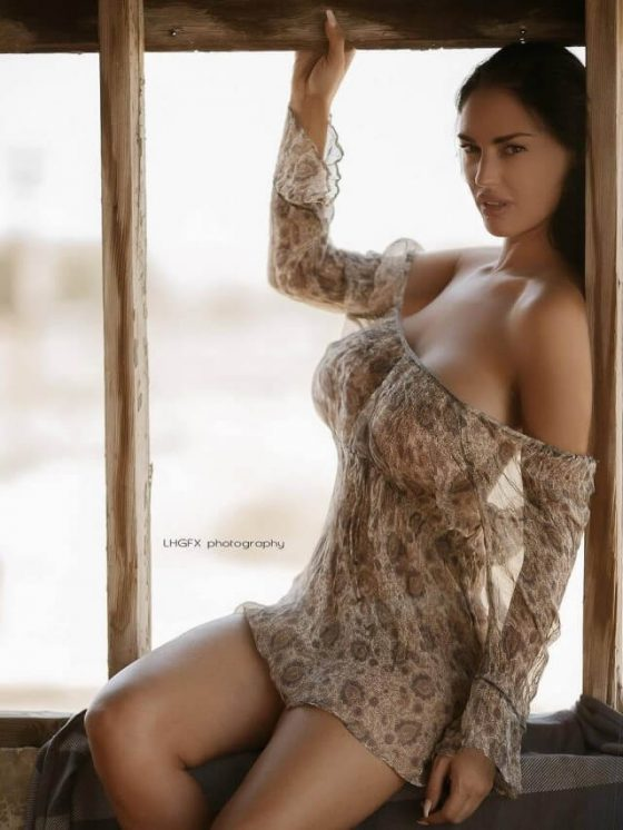 The beautiful breasts of Charlie Riina in a braless girly dress
