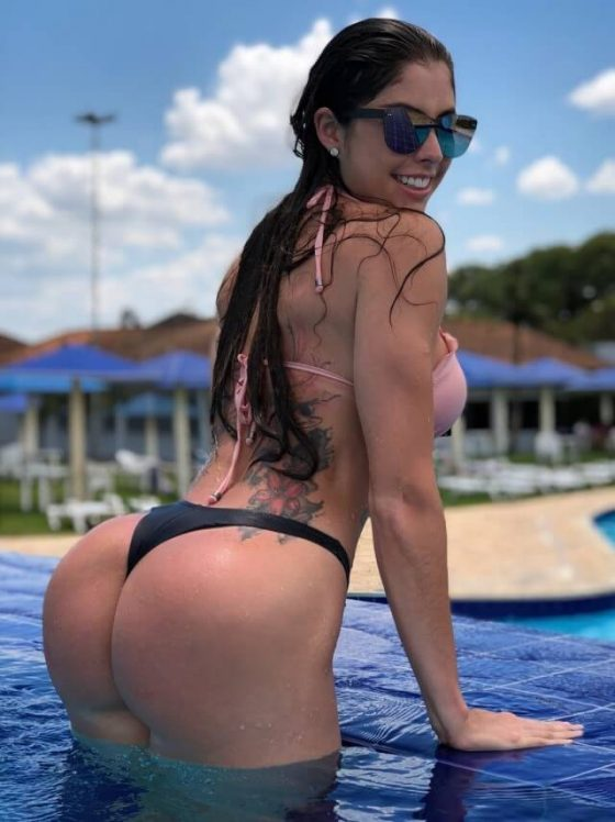 Booty chick Milena Saurin in sexy wet bikini poolside