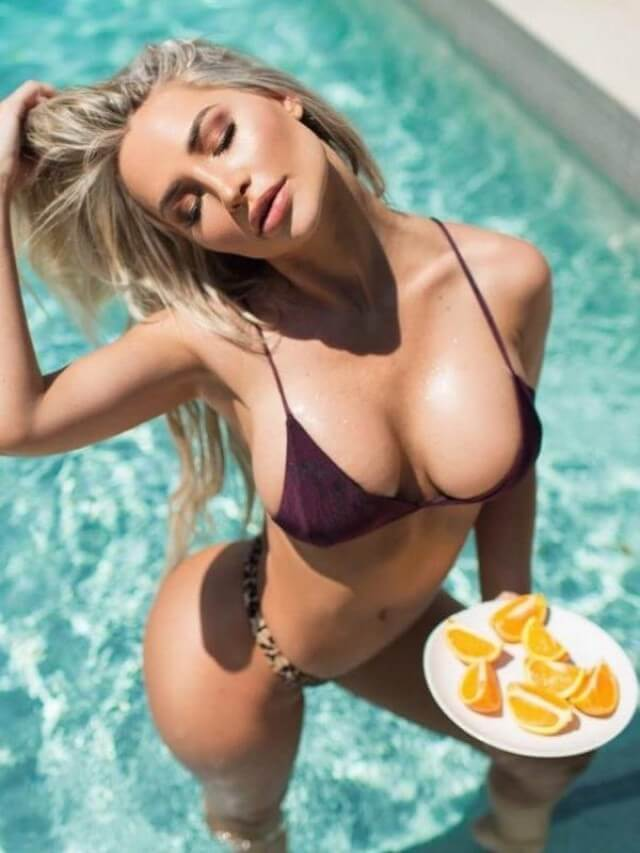 beautiful blonde in bikini with oranges