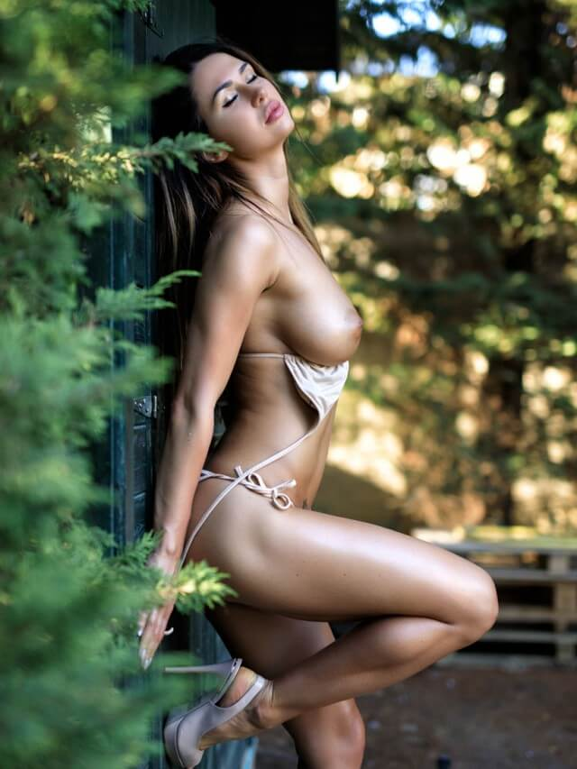 Justina sexy busty babe outdoors