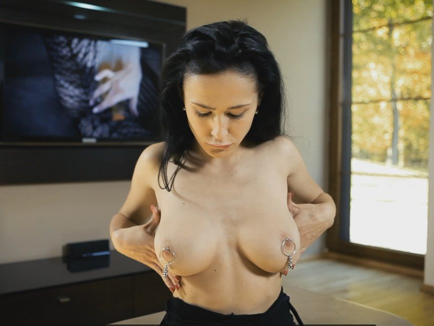 Sexy busty babe topless with nipple rings
