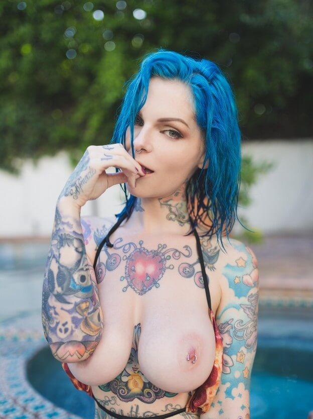 Tattooed woman topless big tits