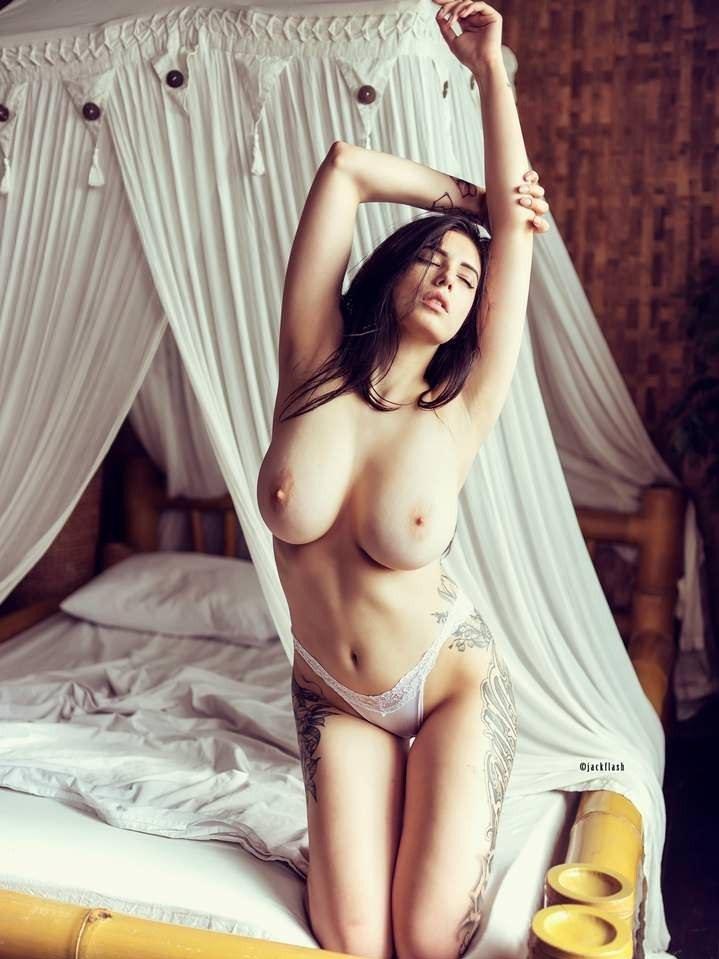 Evgenia Talanina topless sexy pose