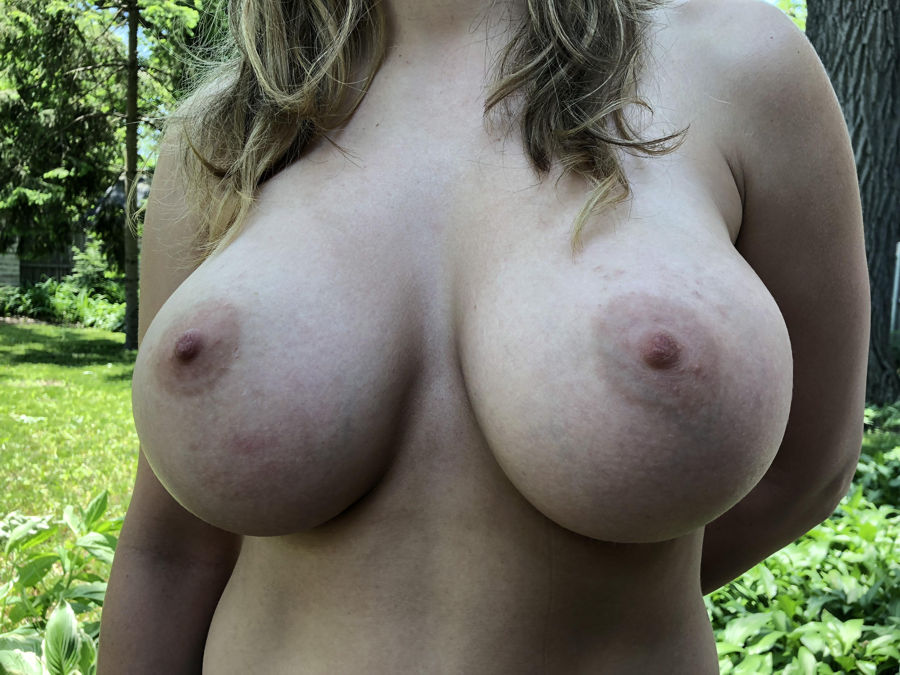 naked huge boobs close-up photo