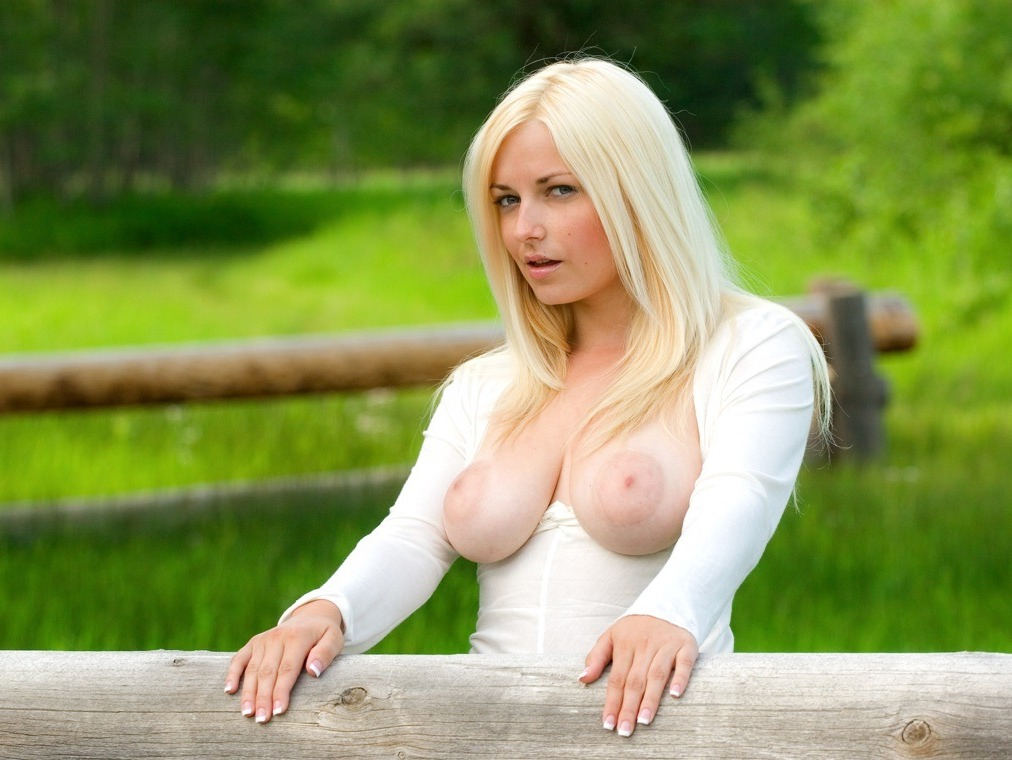 busty blond babe exposes her boobs