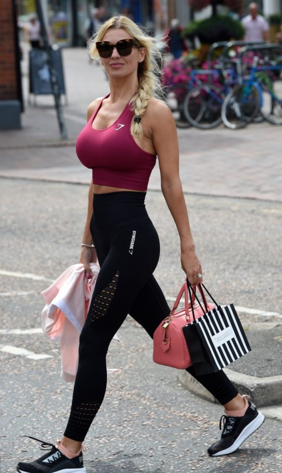 woman with big tits in spots bra shopping