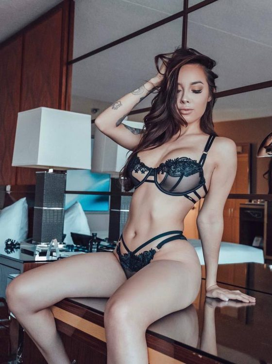 Exotic woman Brittani Paige in sexy black lingerie photo