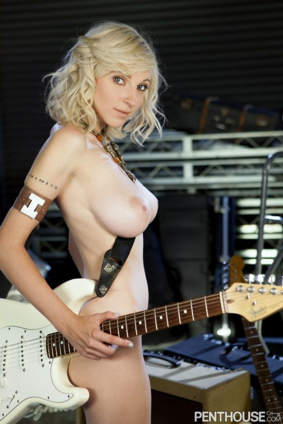sexy babe topless with a guitar
