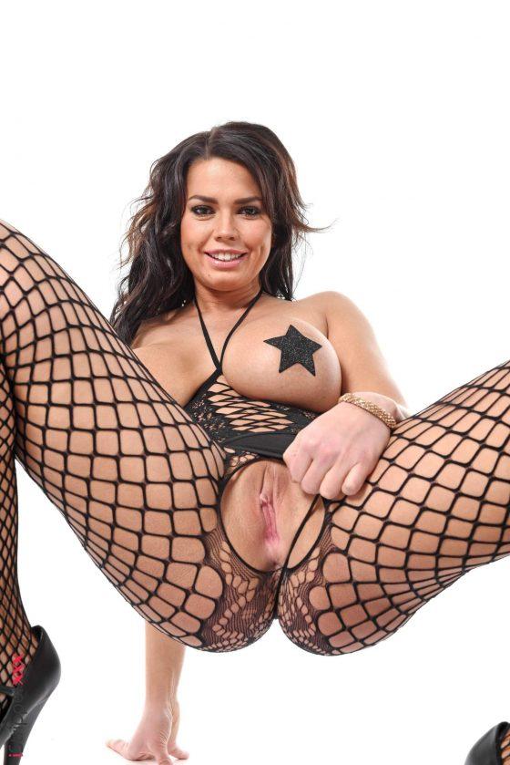 Busty model Chloe Lamoure topless fishnet shot 6