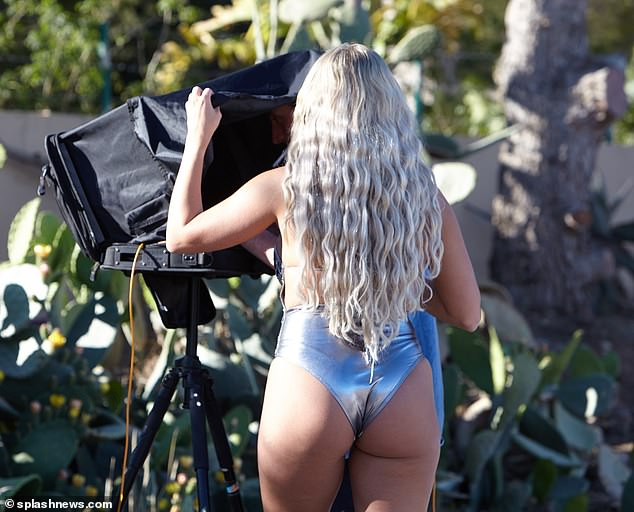 Amber Turner flaunts her sensational curves in a skimpy silver swimsuit