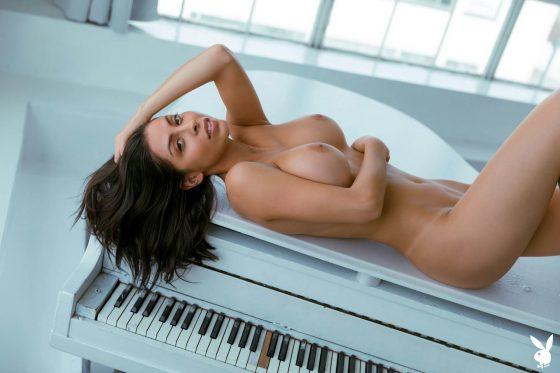 Playboy model Divina nude big tits photo 12