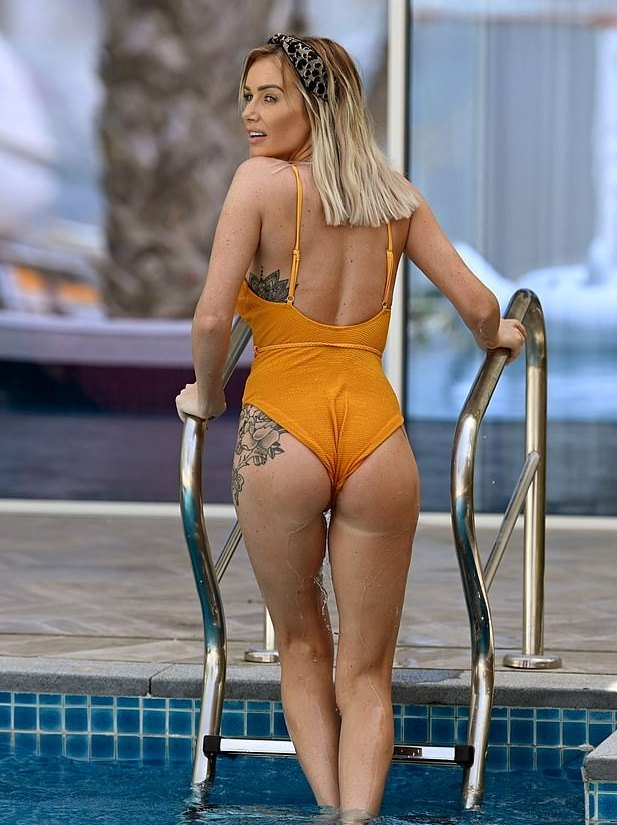 Laura Anderson ass tattoo swimsuit poolside