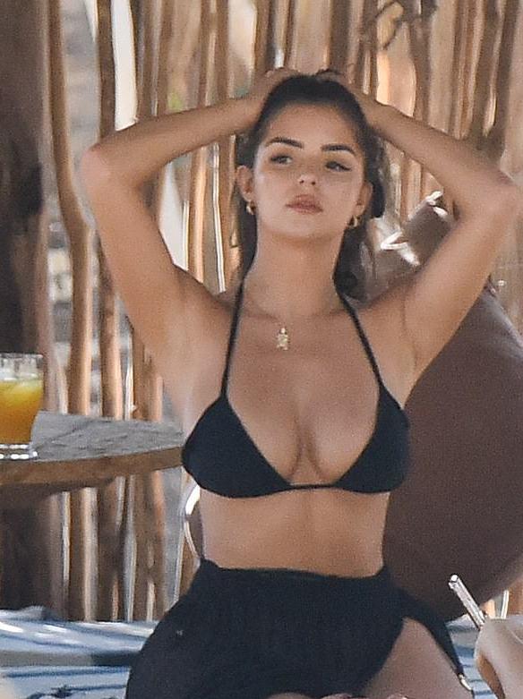 Demi Rose slips into a hot plunging black bikini!