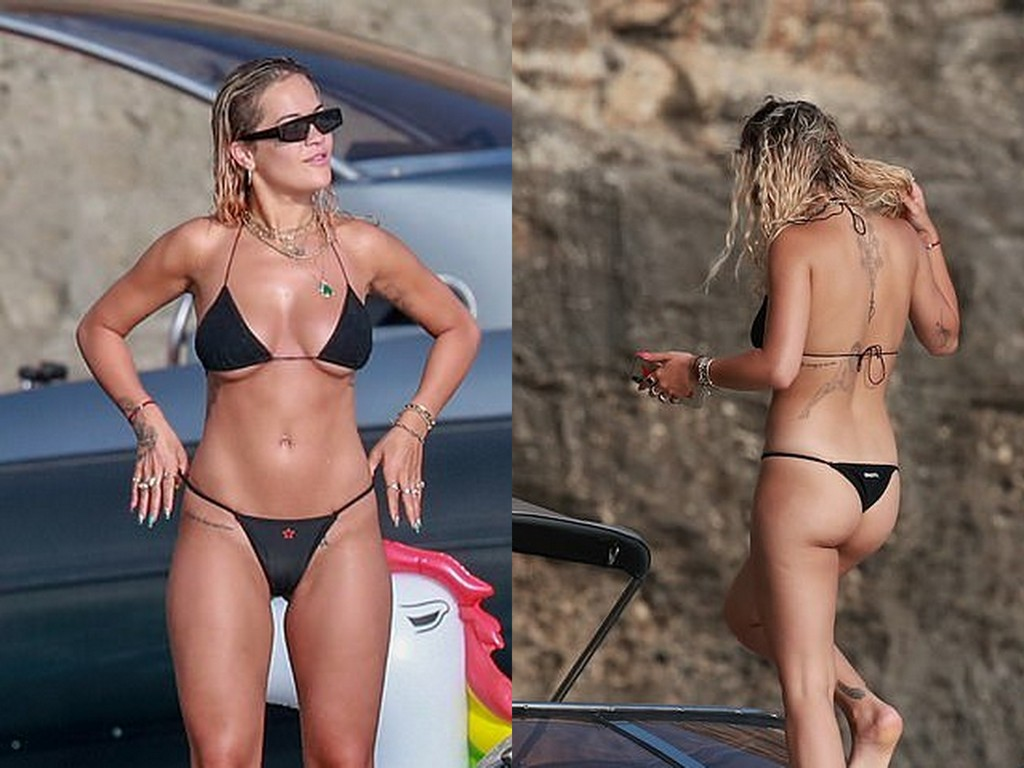 Rita Ora leaves NOTHING to the imagination as she flashes under-boob in a TINY black bikini!